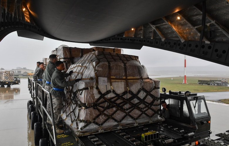 Students of the 721st Aerial Port Squadron's Unit Learning Center prepare pallets of cargo to be loaded onto a C-17 Globemaster III during hands-on training for the class on Ramstein Air Base, Germany, March 21, 2017. The center provides upgrade training for new Airmen from Ramstein; Spangdahlem Air Base, Germany; Royal Air Force Mildenhall, England; and Aviano Air Base, Italy. (U.S. Air Force photo by Senior Airman Tryphena Mayhugh)