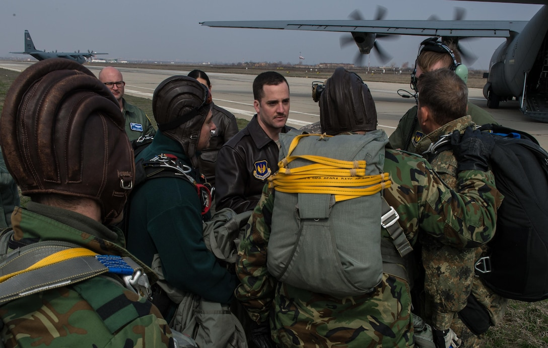 Capt. Tim Vedra, 37th Airlift Squadron C-130J Super Hercules pilot and aircraft commander, discusses an aircraft brief with Bulgarian paratroopers during Exercise Thracian Spring 17 at Plovdiv Regional Airport, Bulgaria, March 15, 2017. The 37th AS air crew and 435th Contingency Response Group jump masters from Ramstein Air Base, Germany, worked directly with the paratroopers to conduct tactical flight training. The training enables the U.S. to maintain a critical mobility hub in support of U.S. training and mission objectives while strengthening relations. (U.S. Air Force photo by Staff Sgt. Nesha Humes)