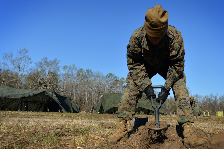 U.S. Marine Corps Lance Cpl. Abdiel Villa, Marine Wing Support Detachment 31 data technician, stationed at Marine Corps Air Station Beaufort, S.C., digs a trench for communication lines at Poinsett Electronic Combat Range near Wedgefield, S.C., March 23, 2017. Villa along with other data technicians provided communication links for Marines in the week-long simulated deployment. (U.S. Air Force photo by Airman 1st Class Christopher Maldonado)