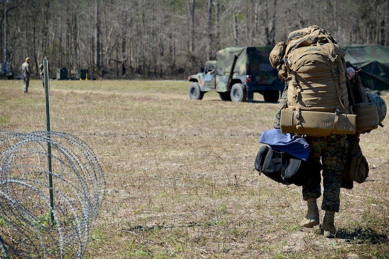 """A U.S. Marine assigned to the Marine Wing Support Detachment 31 (MWSD) stationed at Marine Corps Air Station Beaufort, S.C., arrives to Poinsett Electronic Combat Range near Wedgefield, S.C., March 23, 2017. Marines from the MWSD 31 """"deployed"""" to the range from March 21-30 to test their job proficiency. (U.S. Air Force photo by Airman 1st Class Christopher Maldonado)"""