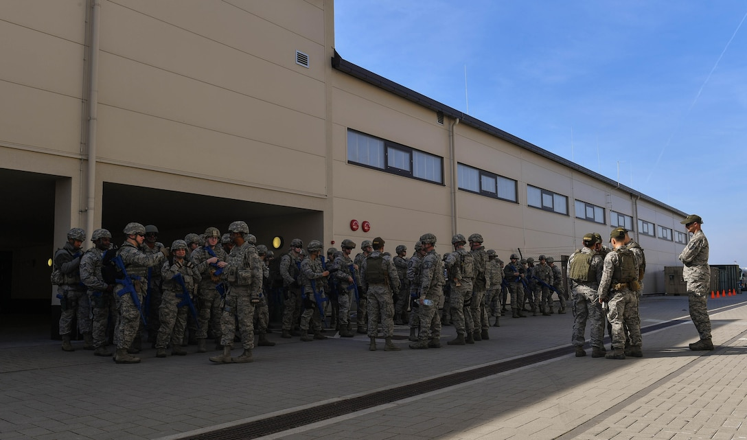 Students and instructors of the 435th Security Forces Squadron's Ground Combat Readiness Training Center's Security Operations Course gather outside before conducting a variety of hands-on training on Ramstein Air Base, Germany, March 25, 2017. The two-week course began March 24 and provides pre-deployment training to security forces Airmen who will be going downrange. Airmen assigned to the 86th SFS, 422nd SFS, 100th SFS, and 569th U.S. Forces Police Squadron participated in the course. (U.S. Air Force photo by Senior Airman Tryphena Mayhugh)