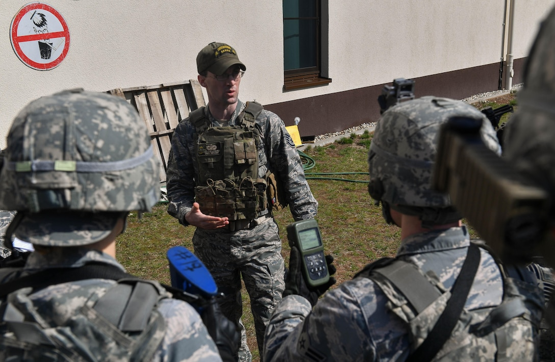 Staff Sgt. Cyle Lamoureux, 435th Security Forces Squadron Ground Combat Readiness Training Center instructor, briefs students on how to use a defense advanced GPS receiver during the DAGR training portion of the Security Operations Course on Ramstein Air Base, Germany, March 25. 2017. The two-week course began March 24 and provides pre-deployment training to security forces Airmen who will be going downrange Airmen assigned to the 86th SFS, 422nd SFS, 100th SFS, and 569th U.S. Forces Police Squadron participated in the course. (U.S. Air Force photo by Senior Airman Tryphena Mayhugh)