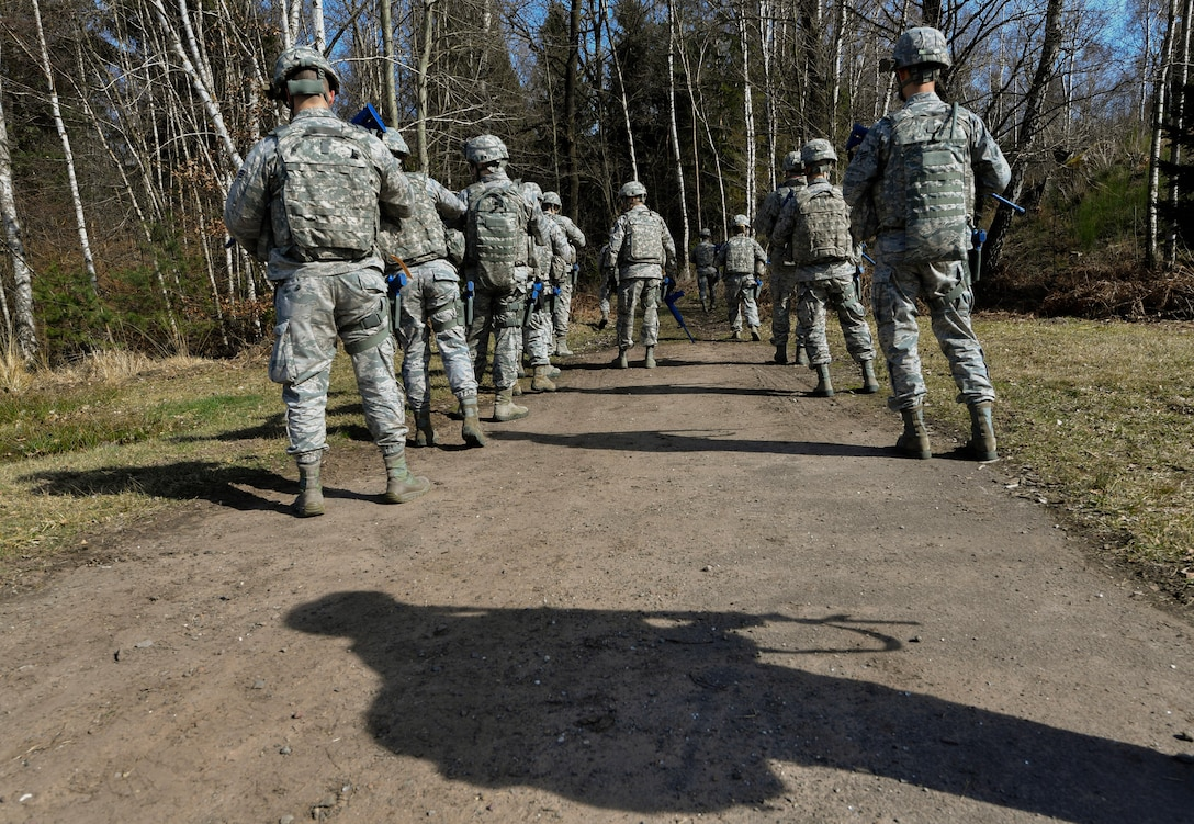 Students of the 435th Security Forces Squadron's Ground Combat Readiness Training Center's Security Operations Course form up before beginning the improvised explosive device detection portion of the course on Ramstein Air Base, Germany, March 25, 2017. During the IED detection portion, the students marched through a wooded area and had to detect devices hidden along the way. Airmen assigned to the 86th SFS, 422nd SFS, 100th SFS, and 569th U.S. Forces Police Squadron participated in the course. (U.S. Air Force photo by Senior Airman Tryphena Mayhugh)