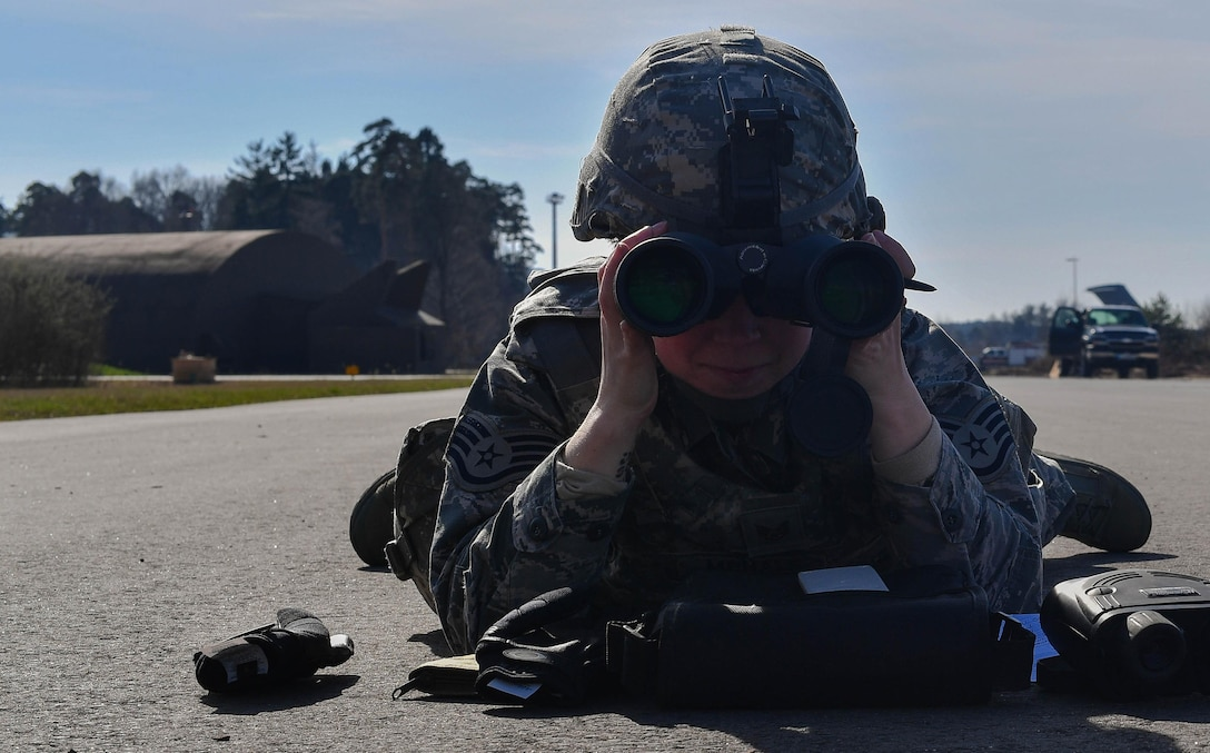 Staff Sgt. Katelyn McHale, 569th U.S. Forces Police Squadron desk sergeant, looks through binoculars to calculate the distance of a target during the range calculation portion of the 435th Security Forces Squadron's Ground Combat Readiness Training Center's Security Operations Course on Ramstein Air Base, Germany, March 25, 2017. The purpose of the two-week course is to prepare security forces Airmen who are deploying down range. The purpose of the two-week course is to prepare security forces Airmen who are deploying down range. Airmen assigned to the 86th SFS, 422nd SFS, 100th SFS, and 569th USFPS participated in the course. (U.S. Air Force photo by Senior Airman Tryphena Mayhugh)