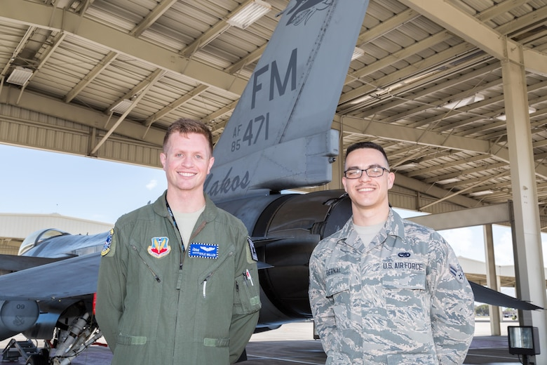Airman 1st Class Joel Bernal, right, with F-16 pilot and USAFA graduate Capt. Kyle Miller. Bernal an F-16 crew chief with the 482nd Aircraft Maintenance Squadron has been selected as one of approximately 1,000 candidates in the nation to be offered a position in U.S. Air Force Academy's 2021 graduating class. (U.S. Air Force photo/Tech. Sgt. Leo Castellano)