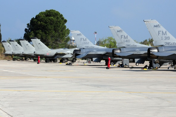 Italian and U.S. Air Force F-16Cs are parked on the flightline at Andravida Air Base Greece, Mar. 27, 2017 during INIOHOS 17.  The U.S. and Greece, as NATO allies, are participating in this exercise to promote peace and stability, and to seek opportunities to continue developing  a relationship. (U.S. Air Force photo by Staff Sgt. Ciara Gosier)