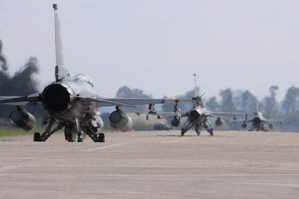 Three F-16C Fighting Falcons from Homestead Air Reserve Base, Fla., taxi for a sortie during INIOHOS 17 at Andravida Air Base, Greece, Mar. 27, 2017. INIOHOS 17 is a Hellenic Air Force-led, large force, flying exercise between NATO Allies and partner nations. (U.S. Air Force photo by Staff Sgt. Ciara Gosier)