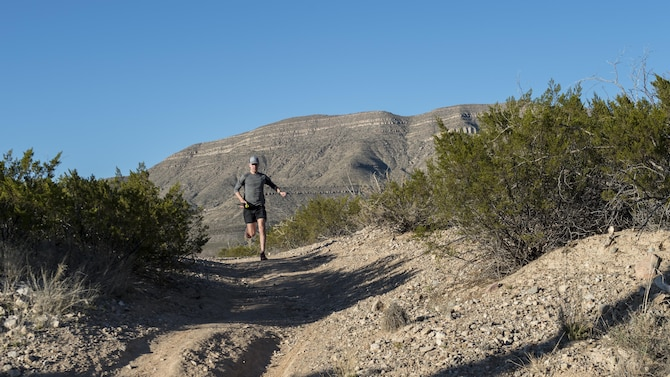 Staff Sgt. Phillip LaPoint, a 49th Maintenance Squadron stockpile technician, runs on a local trail on Feb. 15, 2017 in Alamogordo, N.M. After more than 2,000 miles worth of training, LaPoint ran and placed first in his first 50-mile ultra-marathon outside of Alexandria, Louisiana. (U.S. Air Force photo by Senior Airman Emily Kenney)