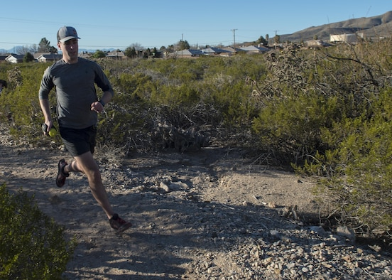 Staff Sgt. Phillip LaPoint, a 49th Maintenance Squadron stockpile technician, runs on a local trail on Feb. 15, 2017 in Alamogordo, N.M. On Jan. 7, 2017, LaPoint completed and won his first 50-mile ultra-marathon outside of Alexandria, Louisiana. (U.S. Air Force photo by Senior Airman Emily Kenney)