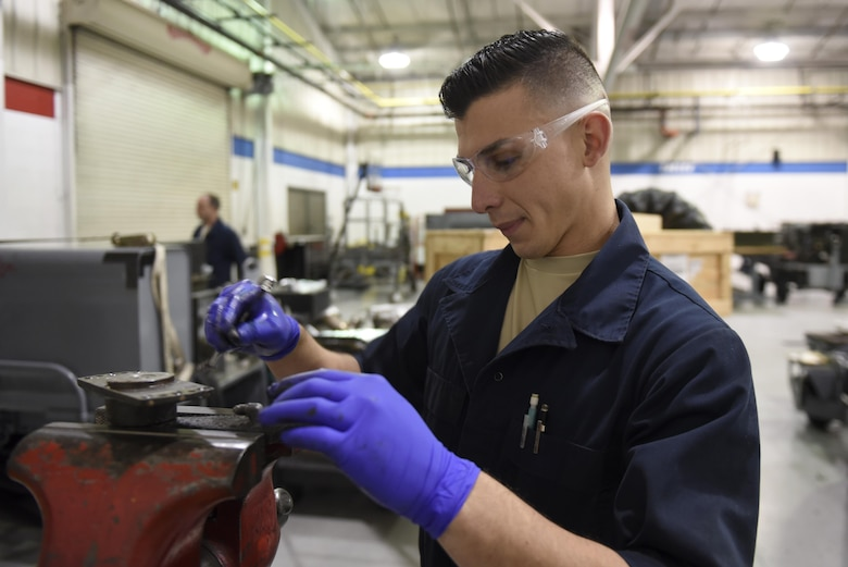 Senior Airman Daniel Angulo-Negron, 4th Equipment Maintenance Squadron aerospace ground equipment technician, examines the bolts on a generator bracket, March 15, 2017, at Seymour Johnson Air Force Base, North Carolina. Repairs, updates and inspections are conducted on the aerospace ground equipment to ensure everything is in proper working order. (U.S. Air Force photo by Airman 1st Class Victoria Boyton)