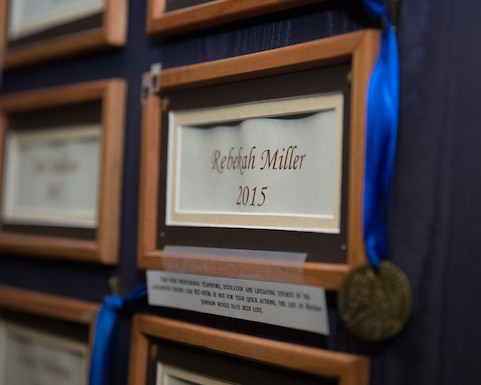 A blue ribbon is draped across a wooden frame surrounding the name Rebekah Miller which is on a board in the Torrington police department, Mar. 10, 2017 in Torrington, Wyoming. Staff Sgt. Rebekah Miller is a member of the Wyoming Air National Guard and has for served six years. She is currently assigned as a command post specialist with the 153rd Airlift Wing. Miller has also been an officer with the Torrington police department for two years. (U.S. Air National Guard photo by Senior Master Sgt. Charles Delano/released)