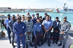 Partners from the Caribbean Basin Security Initiative's (CBSI) Technical Assist Field Team (TAFT) gather for photo aboard U.S. Coast Guard Cutter William Trump following an exchange in Key West, Fla.
