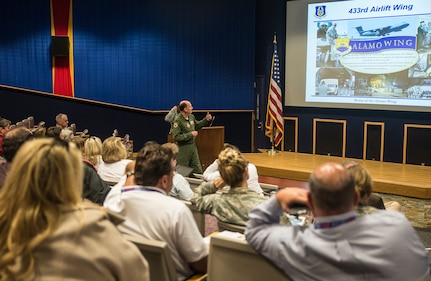 Col. Thomas K. Smith, Jr.,  433rd Airlift Wing commander, gives a wing mission brief to civic leaders from the 403rd Wing, Keesler Air Force Base, Mississippi March 23, 2017 at Joint Base San Antonio-Lackland, Texas.  (U.S. Air Force photo by Benjamin Faske)