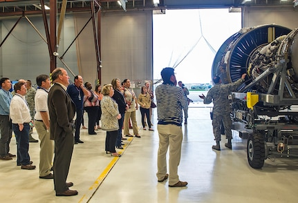 Tech. Sgt. Sean Preston, 433rd Maintenance Squadron aircraft mechanic, explains the benefits of the new C-5M engines to civic leaders from the 403rd Wing, Keesler Air Force Base, Mississippi March 24, 2017 at Joint Base San Antonio-Lackland, Texas. (U.S. Air Force photo by Benjamin Faske)