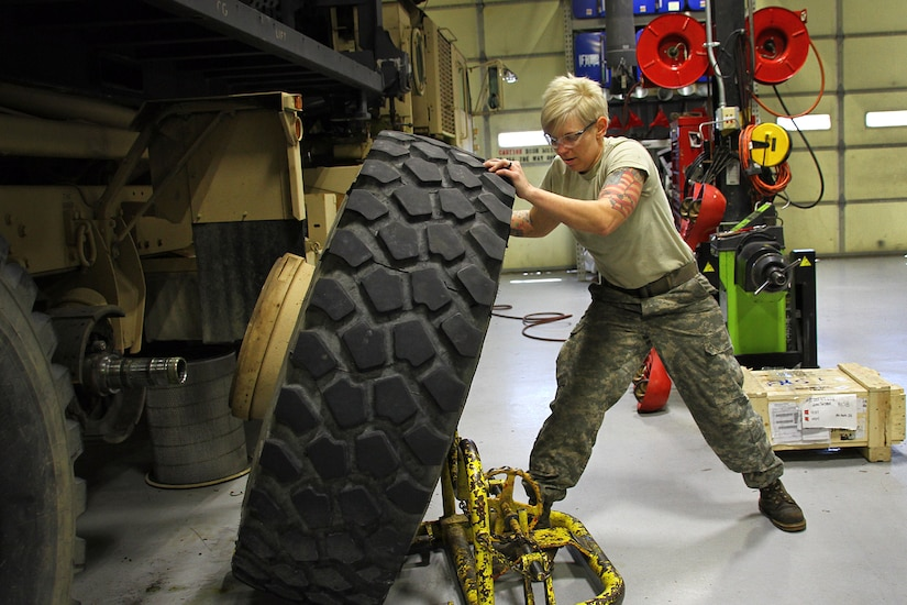 Kentucky Army National Guard Staff Sgt. Kathleen Braithwaite removes a wheel from a M977 Heavy Expanded Mobility Tactical Truck in Frankfort, Ky., March 16, 2017. Kentucky Army National Guard photo by Staff Sgt. Scott Raymond