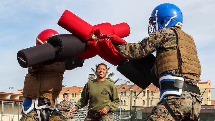 Marines assigned to Special Purpose Marine Air-Ground Task Force Crisis Response – Africa spar with pugil sticks during martial arts training at Naval Air Station Sigonella, Italy, March 24, 2017. Marine Corps photo by Cpl. Samuel Guerra