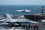 """170318-N-YL257-006  U.S. 5TH FLEET AREA OF OPERATIONS (March 18, 2017) An EA-18G Growler attached to the """"Lancers"""" of Electronic Attack Squadron (VAQ) 131 launches from the flight deck of the aircraft carrier USS George H.W. Bush (CVN 77). The carrier is part of the George H.W. Bush Carrier Strike Group and is deployed in support of maritime security operations and theater security cooperation efforts in the U.S. 5th Fleet area of operations. (U.S. Navy photo by Mass Communication Specialist 3rd Class Christopher Gaines/Released)"""