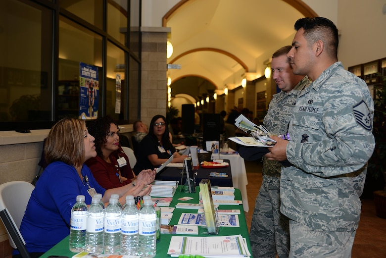 Master Sgt. Jose Cruzbarbosa, 47th Security Forces Squadron section chief, speaks with a local representative during a health expo on Laughlin Air Force Base, Texas, March 22, 2017. The health expo brought together various on-base and off-base agencies that promote fitness, heal and wellness. (U.S. Air Force photo/ Airman 1st Class Benjamin N. Valmoja)