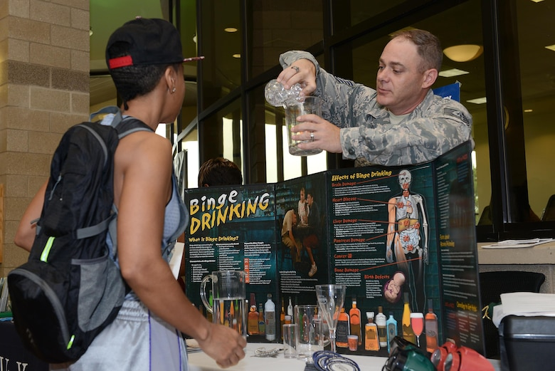 Technical Sgt. Jeremy Bennett, 47th Medical Operations Squadron mental health flight chief, demonstrates common misconceptions with alcohol during a health expo on Laughlin Air Force Base, Texas, March 22, 2017. The health expo brought together various on-base and off-base agencies that promote fitness, heal and wellness. (U.S. Air Force photo/ Airman 1st Class Benjamin N. Valmoja)