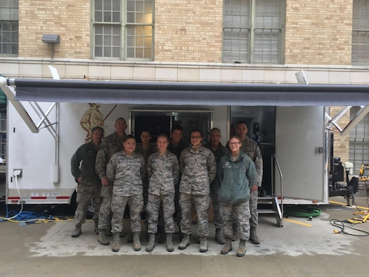 Airmen of the 143d Force Support Squadron stand in front of the Disaster Relief Mobile Kitchen Trailer (DRMKT) in preparation to support the 58th Presidential Inauguration. Photo provided by Staff Sergeant Meghan Vittorioso