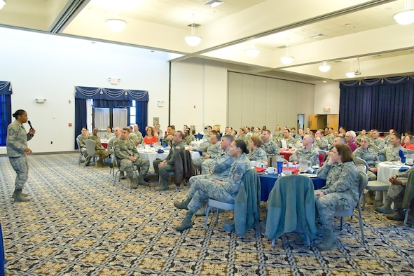 Team Dover members listen to Chief Master Sgt. Shelina Frey, command chief for Air Mobility Command, Scott Air Force Base, Ill., speak at the Women's History Month Breakfast, March 20, 2017, at The Landings on Dover Air Force Base, Del. Frey was the guest speaker for the event and noted the importance of her having good mentors during her Air Force career. (U.S. Air Force photo by Roland Balik)