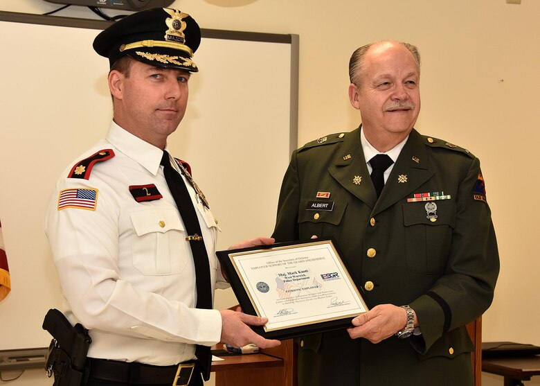 ESGR Volunteer Retired First Lieutenant Phil Albert (right) presents the Patriot Award to Major Mark Knott of the West Warwick Police Department