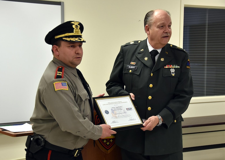 ESGR Volunteer Retired First Lieutenant Phil Albert (right) presents the Patriot Award to Captain Peter Appollonio of the West Warwick Police Department