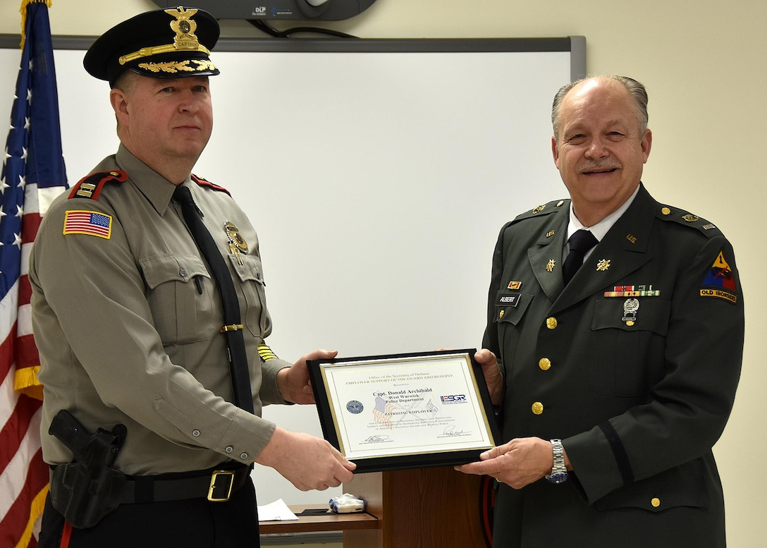 ESGR Volunteer Retired First Lieutenant Phil Albert (right) presents the Patriot Award to Captain Donald Archibald of the West Warwick Police Department