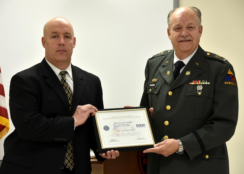 ESGR Volunteer Retired First Lieutenant Phil Albert (right) presents the Patriot Award to Captain Ernest Levigne of the West Warwick Police Department
