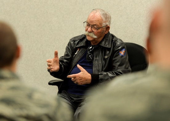 """Robert Schilling, a former Airman and gunner on the AC-47 """"Spooky,"""" tells stories of his military experience to a class inside the Airman Leadership School at Ellsworth Air Force Base, S.D., March 20, 2017. During his presentation, Schilling shared stories of his time in Vietnam and how good leadership can make a difference in a life-or-death situation. (U.S. Air Force photo by Airman 1st Class Randahl J. Jenson)"""