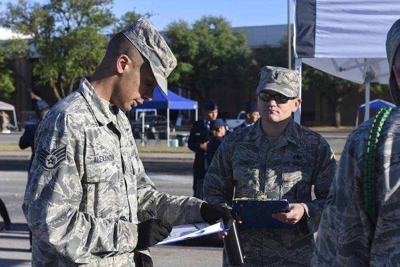 U.S. Air Force Staff Sgt. Terrence Alexander, 316th Training Squadron instructor, adds points at the 19th Annual Drill Competition at Angelo State University in San Angelo, Texas, March 25, 2017. The points were used to see which team would win the exhibition drill category. (U.S. Air Force photo by Airman 1st Class Chase Sousa/Released)