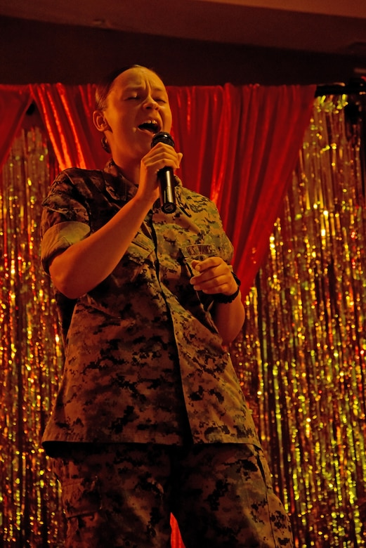 """U.S. Marine Corps Lance Cpl. Morgan Piatt, Marine Corps Detachment student, sings during """"Goodfellow's Got Talent"""" at the event center on Goodfellow Air Force Base, Texas, March 24, 2017. She placed first in the show. (U.S. Air Force photo by Staff Sgt. Joshua Edwards/Released)"""