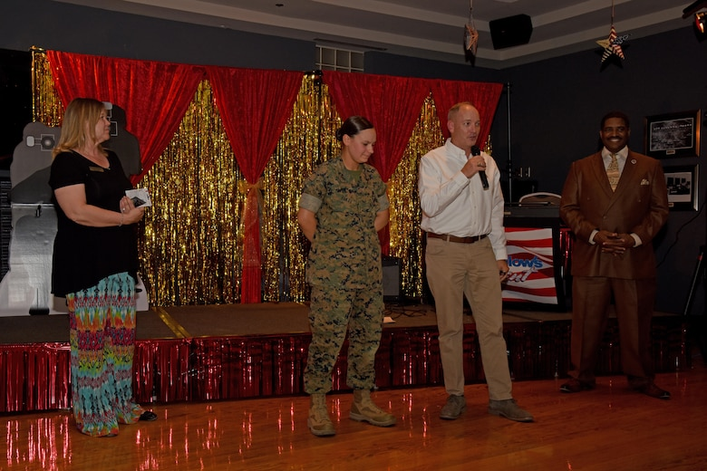 """U.S. Air Force Col. Michael Downs, 17th Training Wing Commander, speaks at the end of """"Goodfellow's Got Talent"""" at the event center on Goodfellow Air Force Base, Texas, March 24, 2017. Downs thanked everyone for attending and congratulated U.S. Marine Corps Lance Cpl. Morgan Piatt, Marine Corps Detachment student, and the winners of the event. (U.S. Air Force photo by Staff Sgt. Joshua Edwards/Released)"""