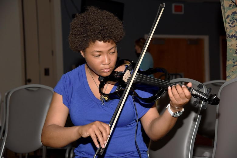 U.S. Air Force Airman 1st Class Lenay Tyler, 315th Training Squadron student, plays an electric violin during a warm-up session before Goodfellow's Got Talent at the event center on Goodfellow Air Force Base, Texas, March 24, 2017. The talent show featured 10 acts that included poetry, singing and dancing. (U.S. Air Force photo by Staff Sgt. Joshua Edwards/Released)