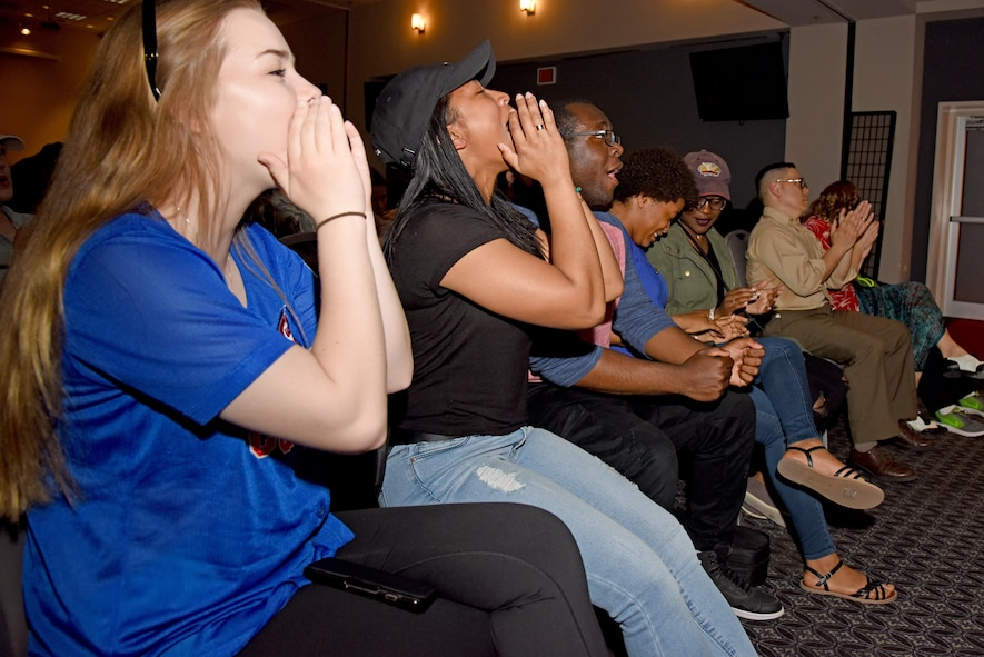 """The crowd cheers and claps during """"Goodfellow's Got Talent"""" at the event center on Goodfellow Air Force Base, Texas, March 24, 2017. The judges monitored crowd participation as one of the categories scored. (U.S. Air Force photo by Staff Sgt. Joshua Edwards/Released)"""
