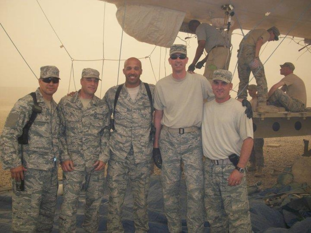 Tech. Sgt. Terrance Williams, center, currently 22nd Security Forces Squadron resources NCO in-charge, poses for a photo July 2011, in Balad, Iraq. Williams deployed nine times during his career, six of which were to combat locations. (Courtesy photo)