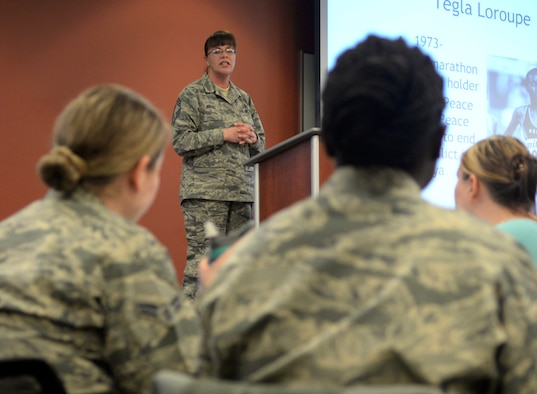Chief Master Sgt. Tracey House, the 28th Medical Group superintendent, speaks during a Women's History Month luncheon inside the Deployment Center at Ellsworth Air Force Base, S.D., March 21, 2017. House, along with two other guest speakers, spoke on her experiences in the military and how women in her life have helped shape her career. (U.S. Air Force photo by Airman 1st Class Denise M. Jenson)