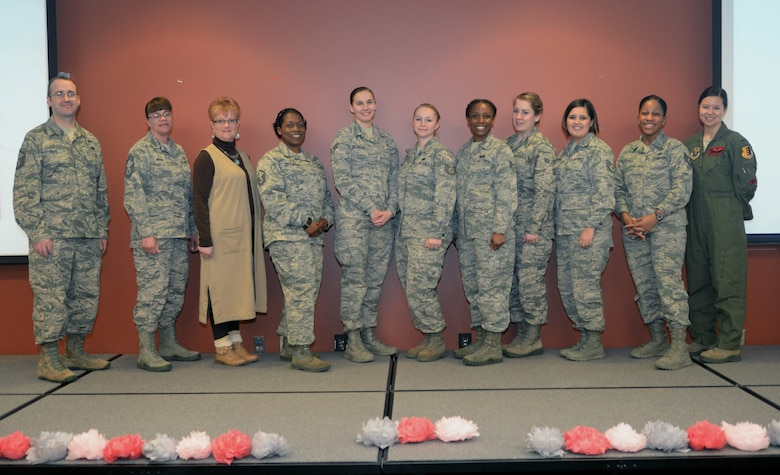 Attendees and guest speakers from the Women's History Month luncheon pose for a photo inside the Deployment Center at Ellsworth Air Force Base, S.D., March 21, 2017. The luncheon was hosted by members of Ellsworth's Diversity Council, and focused on the evolution of the role of women in the military and in society. (U.S. Air Force photo by Airman 1st Class Denise M. Jenson)