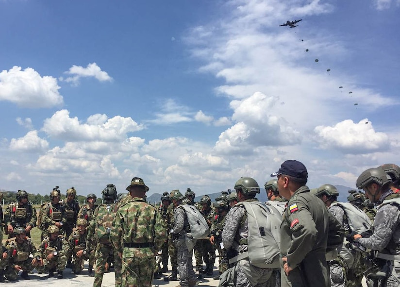 A Wyoming Air National Guard C-130 Hercules, air drops special forces from the U.S. Army, Colombian Army, Navy and Air Force during a training scenario in Bogota, Colombia. The 571st Mobility Support Advisory Squadron, alongside Airmen from five other squadrons spent three weeks training the Colombian forces in air operations, aeromedical evacuation, propeller balance, zodiac rigging and medical intelligence courses. (Courtesy Photo)