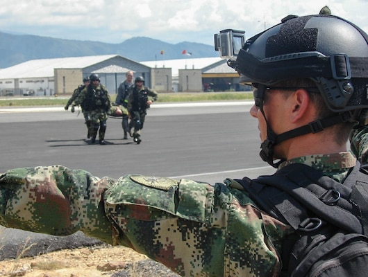 Service members from the Colombian Air Force and Army, transfer a simulated patient from a Colombian UH-60 Helicopter to a United States Air Force C-130 Hercules during a training scenario in Bogota, Colombia. The 571st Mobility Support Advisory Squadron, alongside Airmen from five other squadrons spent three weeks training the Colombian forces in air operations, aeromedical evacuation, propeller balance, zodiac rigging and medical intelligence courses. (Courtesy Photo)