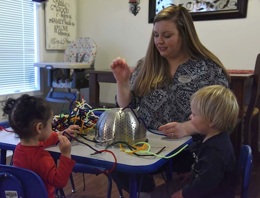 Liz Arrexi, 341st Force Support Squadron family child care home provider, plays a game with children to increase their motor skills March 24, 2017, at Malmstrom Air Force Base, Mont. Arrexi has been an FCC provider for a year and does it to support the mission of the base. (U.S. Air Force photo/Senior Airman Jaeda Tookes)