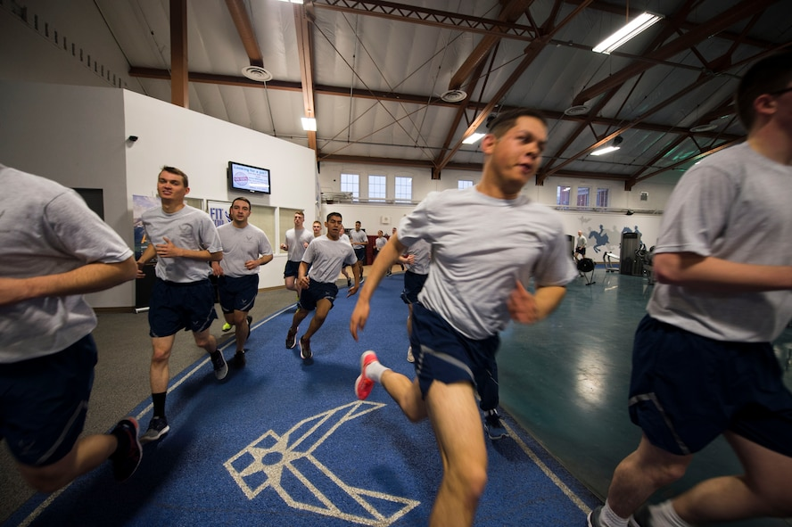"Members of the 790th Missile Security Forces Squadron run ""Last Airman Up"" on the indoor track during squadron physical training on F.E. Warren Air Force Base, Wyo., Feb. 1, 2017. During the winter months, many squadrons utilize the indoor gym to conduct their squadron PT. (U.S. Air Force photo by Staff Sgt. Christopher Ruano)"