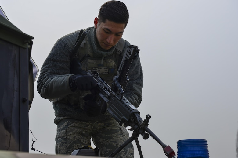 U.S. Air Force Airman 1st Class Alexander Choi, 51st Security Forces Squadron turret gunner, prepares an M240 machine gun during a field training exercise at Osan Air Base, Republic of Korea, March 23, 2017. The field training exercise was one of the final parts of the 51st SFS Combat Readiness Course, where Defenders spend 10 days expanding their knowledge on defending the base, executing contingency operations and sustaining the force. (U.S. Air Force photo by Staff Sgt. Victor J. Caputo)