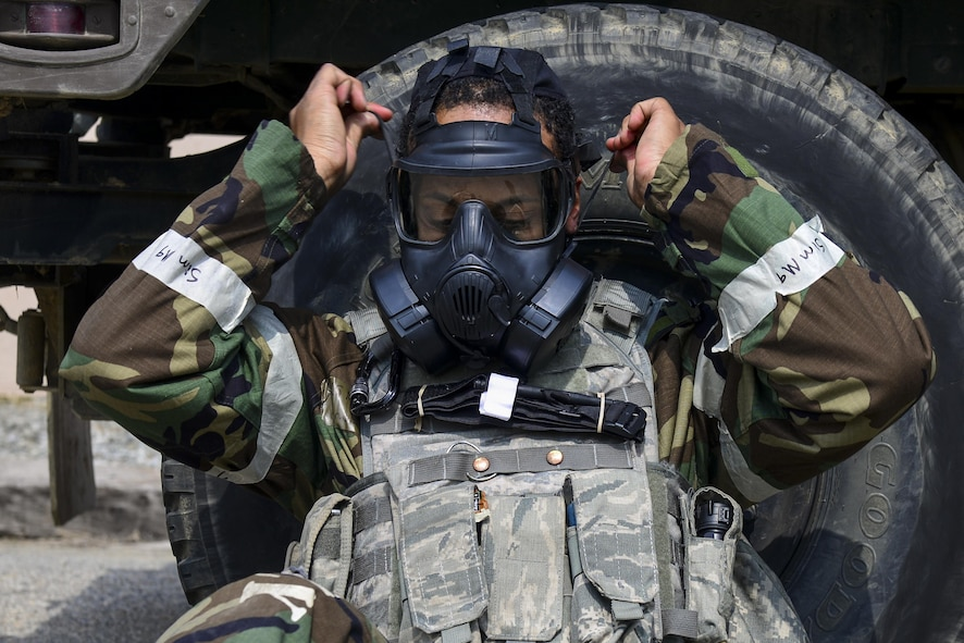 U.S. Air Force Staff Sgt. Prince Johnson, 51st Security Forces Squadron Defender, dons his gas mask during a field training exercise at Osan Air Base, Republic of Korea, March 23, 2017. Johnson was part of a group of Defenders who went through the 51st SFS Combat Readiness Course, a 10-day program that covers basic and advanced contingency operations and base-specific defense tactics, including the use of Mission Oriented Protective Posture gear. (U.S. Air Force photo by Staff Sgt. Victor J. Caputo)