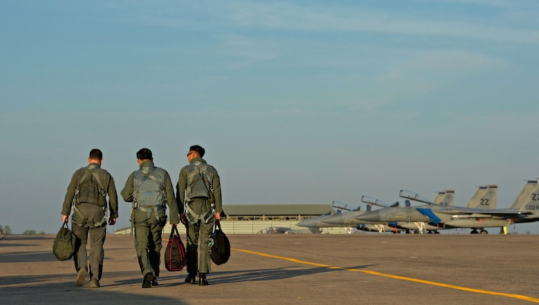 U.S. Air Force Lt. Col. James McFarland (left), Royal Thai air force Group Capt. Supijjarn Thamwatharsaree (center) and Republic of Singapore air force Col. Chan Ching Hao, exercise directors for Cope Tiger 17 (CT17) walk along the flightline during CT17 at Korat Royal Thai Air Force Base, Thailand, March 28, 2017. The annual multilateral exercise, which involves a combined total of 76 aircraft and 43 air defense assets, is aimed at improving combined combat readiness and interoperability between the Republic of Singapore air force, Royal Thai air force, and U.S. Air Force, while concurrently enhancing the three nations' military relations. (U.S. Air Force photo by Staff Sgt. Kamaile Chan)