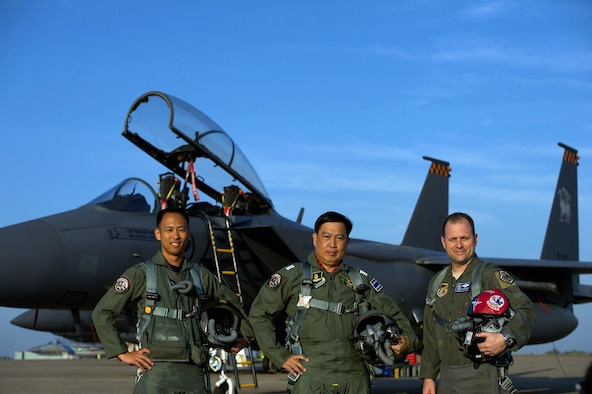Republic of Singapore air force Col. Chan Ching Hao (left), Royal Thai air force Group Capt. Supijjarn Thamwatharsaree (center), and U.S. Air Force Lt. Col. James McFarland pose for a photo during exercise Cope Tiger 17 at Korat Royal Thai Air Force Base, Thailand, March 28, 2017. The annual multilateral exercise, which involves a combined total of 76 aircraft and 43 air defense assets, is aimed at improving combined combat readiness and interoperability between the Republic of Singapore air force, Royal Thai air force, and U.S. Air Force, while concurrently enhancing the three nations' military relations. (U.S. Air Force photo by Staff Sgt. Kamaile Chan)