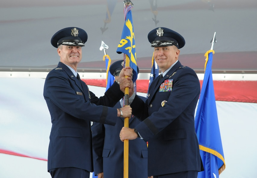 Lt. Gen. Darryl Roberson, commander of Air Education and Training Command, passes the 19th Air Force guidon to Brig. Gen. Patrick J. Doherty, during the 19th Air Force change of command ceremony March 28, 2017, at Joint Base San Antonio-Randolph, Texas.  Members of the numbered Air Force unit will oversee 19 training locations, with 16 total force wings, 10 active duty, one Air Force Reserve and five Air National Guard units.  More than 32,000 members of 19th Air Force operate more than 1,350 aircraft from 29 different aircraft models.  Members of the 19th Air Force are responsible for training aircrews, air battle managers and weapons directors, plus Air Force Academy Airmanship Programs and Survival, Evasion, Resistance and Escape training.(U.S. Air Force photo by Joel Martinez)
