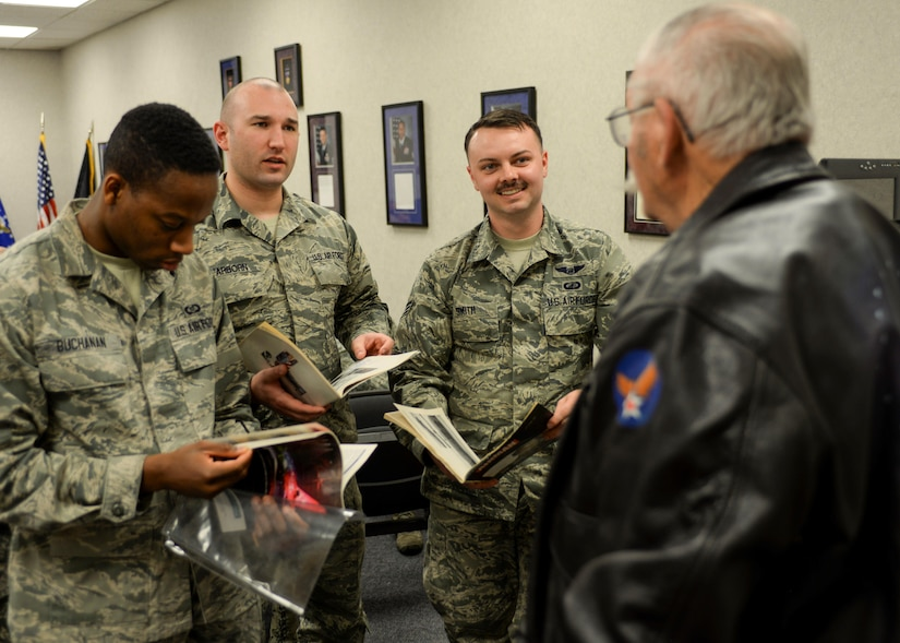 """Airmen ask questions of Robert Schilling, a former Airman and gunner on the AC-47 """"Spooky,"""" inside the Airman Leadership School at Ellsworth Air Force Base, S.D., March 20, 2017. Schilling was an Airman during the Vietnam War, and now tells his stories to help enlighten the next generation of Air Force leaders. (U.S. Air Force photo by Airman 1st Class Randahl J. Jenson)"""