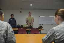 Staff Sgt. Colin Huffaker, 374th Civil Engineer Squadron fire emergency services crew chief, briefs personnel on how to properly use a Self-Contained Breathing Apparatus at Yokota Air Base, Japan, March 24, 2017. The briefing entailed how to properly put together the SCBA, inspect the piece of equipment and how to use it. (U.S. Air Force photo by Staff Sgt. David Owsianka)