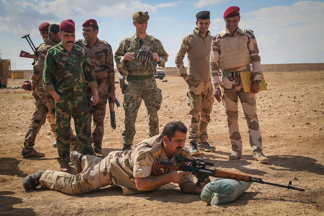 An Iraqi security forces colonel prepares to fire his Dragunov rifle under the supervision of a British trainer deployed in support of Combined Joint Task Force – Operation Inherent Resolve and assigned to The Highlanders, 4th Battalion, The Royal Regiment of Scotland (4 Scots) during sniper training at Al Asad Air Base, Iraq, March 21, 2017. This training is part of the overall CJTF – OIR building partner capacity mission by training and improving the capability of partnered forces fighting ISIS. CJTF – OIR is the global Coalition to defeat ISIS in Iraq and Syria. (U.S. Army photo by Sgt. Lisa Soy